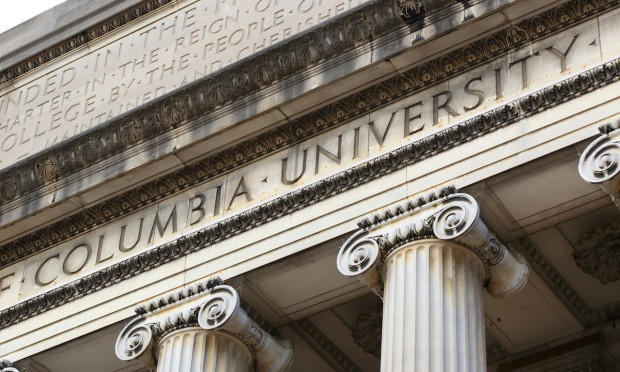 New York City, New York, USA - December 31, 2014: Columbia University inscribed on the Low Memorial Library facade at New York City's Columbia University