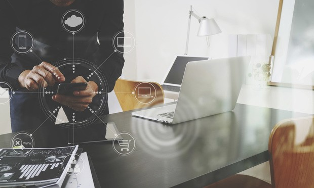 businessman or Designer using smart phone with laptop and digital tablet computer and document on desk in modern office with virtual interface graphic icons network diagram.